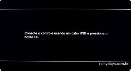 Conecte o controle usando um cabo USB e então pressione o botão PS Playstation 3